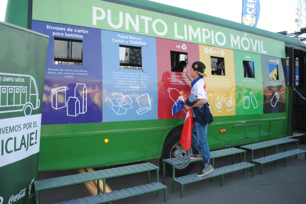 A mobile Punto Limpio, built from a bus. The recyclable material is deposited through the windows. Each window is inside a panel painted in a different color. Each color represents the type of material that window can receive.